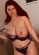 Big breasted mature slut getting naked