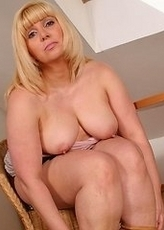 Hot blonde mature lsut playing with her shaved pussy